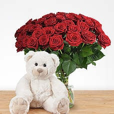 10 or more red roses with bear