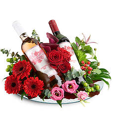 Flower arrangement with red and rose prestige wine